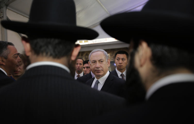 Israeli Prime Minister Benjamin Netanyahu, center, meets rabbis as he visits the Shanghai Jewish Refugees Museum at former site of Ohel Moshe Synagogue in Shanghai, China, Tuesday, May 7, 2013. China is hosting both the Palestinian and Israeli leaders this week in a sign of its desire for a larger role in the Middle East. (AP Photo/Eugene Hoshiko)