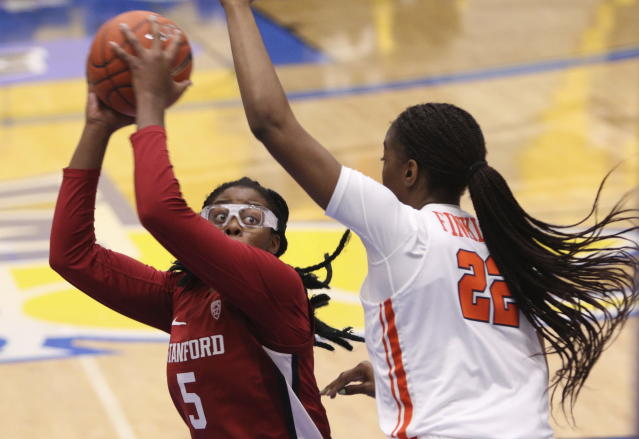 Stanford's Francesca Belibi is defended by Syracuse's Amaya Finklea-Guity during the first half of an NCAA college basketball game Friday, Nov. 29 2019, in Victoria, British Columbia. (Chad Hipolito/The Canadian Press via AP)
