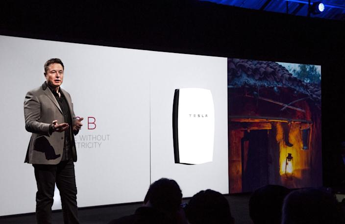 "Tesla CEO Elon Musk introduces the Powerwall residential battery at the company's design studio in Hawthorne in 2015. <span class=""copyright"">(Jerome Adamstein / Los Angeles Times)</span>"