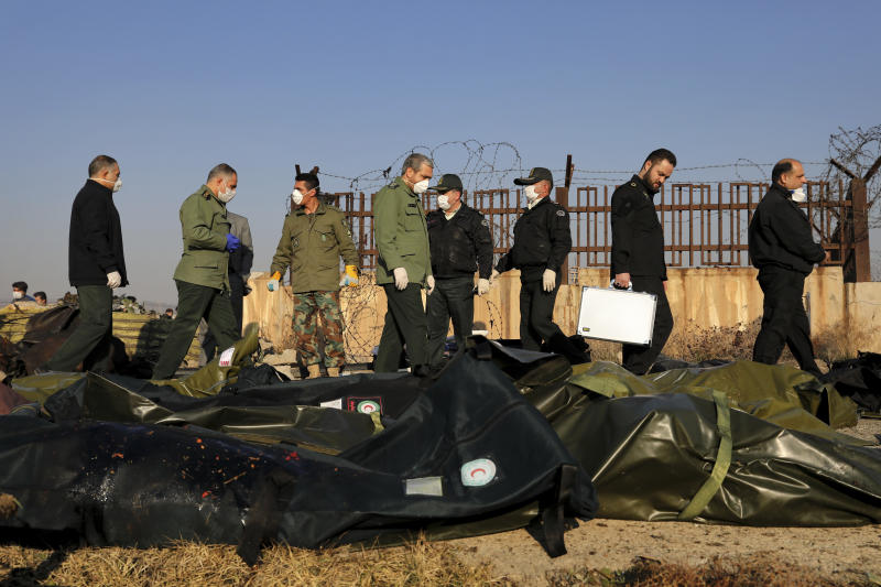 Security personnel work at the scene where a Ukrainian plane crash in Shahedshahr, southwest of the capital Tehran, Iran, Wednesday, Jan. 8, 2020. (Photo: Ebrahim Noroozi/AP)