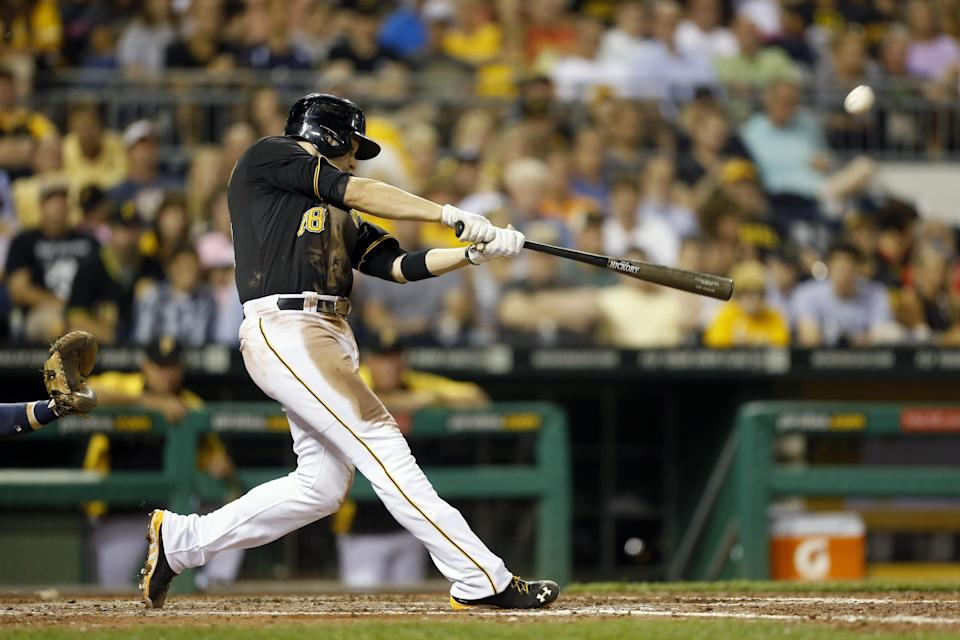 Pittsburgh Pirates' Neil Walker hits a two-run home run during the fifth inning of a baseball game against the Milwaukee Brewers on Tuesday, Aug. 27, 2013, in Pittsburgh. (AP Photo/Keith Srakocic)