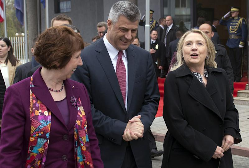 Prime Minister Hashim Thaci of Kosovo walks alongside US Secretary of State Hillary Clinton, right, and High Representative for EU Foreign Policy Catherine Ashton, left, prior to a meeting at the Prime Minister's Office in Pristina, Kosovo, on Wednesday Oct. 31, 2012. Clinton is to held talks with Kosovo leaders to urge them to step up its efforts to secure a lasting peace in the volatile Balkan region. (AP PHOTO / Saul Loeb)