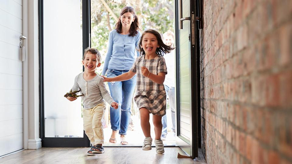 Excited Children Arriving Home With Parents - Image.