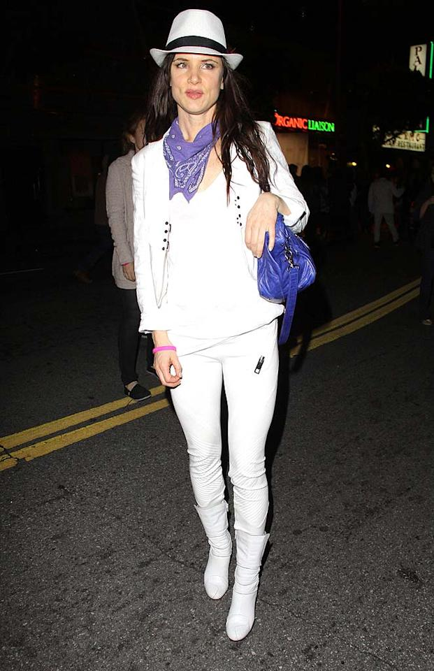 """We think wearing white after Labor Day and before Memorial Day is fine, especially if you live in Southern California (as Juliette Lewis does). However, we don't think an entire white ensemble (complete with outdated fedora and matching boots) is ever acceptable, regardless of one's star status. Josephine Santos/<a href=""""http://www.pacificcoastnews.com/"""" target=""""new"""">PacificCoastNews.com</a> - March 9, 2011"""