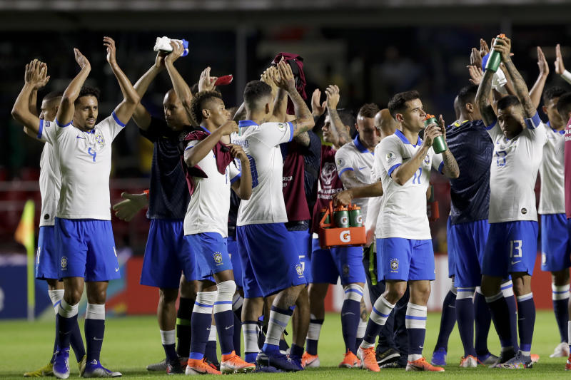 Brazil players celebrate beating 3-0 Bolivia in the opening match of the Copa America at the Morumbi stadium in Sao Paulo, Brazil, Friday, June 14, 2019. (AP Photo/Andre Penner)