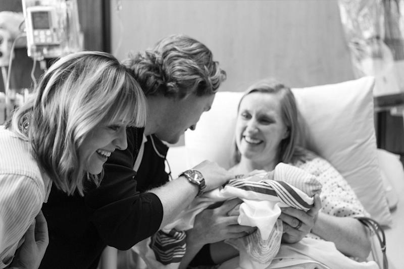Kelsey Nixon and her husband greet their baby, Nora