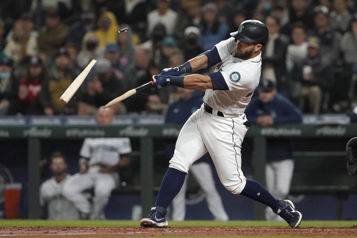 Seattle Mariners' Jose Marmolejos breaks his bat as he grounds out to end the fourth inning of a baseball game against the Houston Astros, Monday, Aug. 30, 2021, in Seattle. (AP Photo/Ted S. Warren)