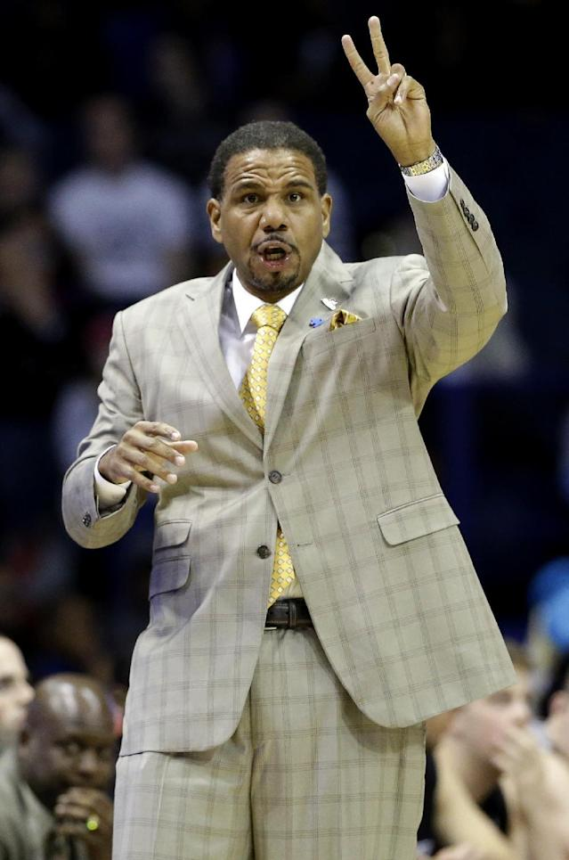 Providence head coach Ed Cooley shouts directions to his team during the first half of an NCAA college basketball game against DePaul in Rosemont, Ill., on Saturday, Feb. 1, 2014. (AP Photo/Nam Y. Huh)