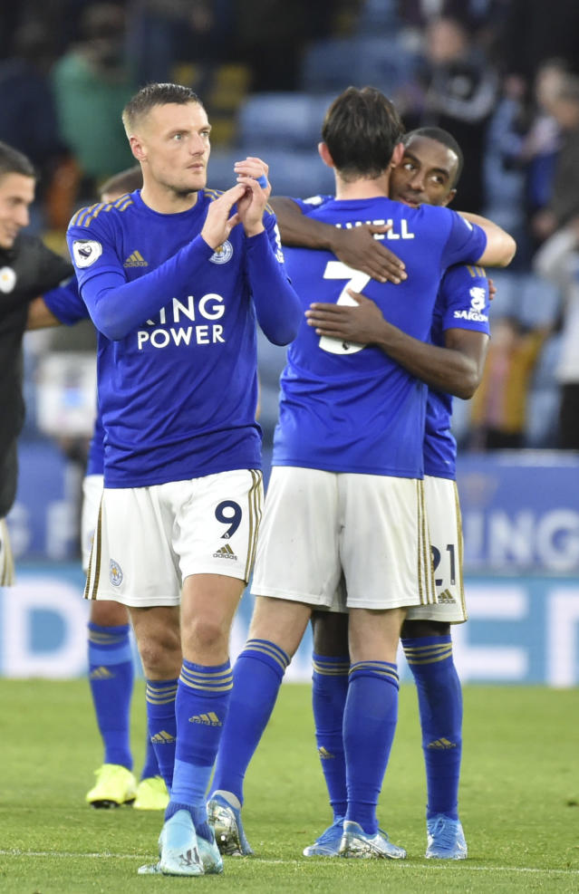 Leicester's Jamie Vardy, left, and his teammates react after the English Premier League soccer match between Leicester City and Newcastle United at the King Power Stadium in Leicester, England, Sunday, Sept. 29, 2019. (AP Photo/Rui Vieira)