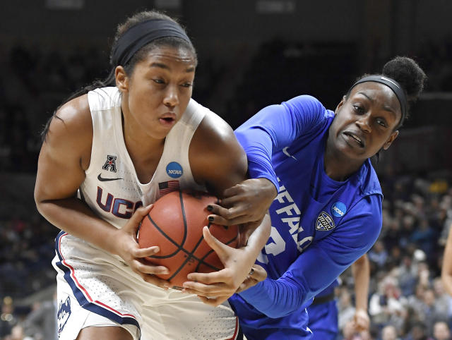 Buffalo's Brittany Morrison, right, pressures Connecticut's Megan Walker during the first half of a second-round women's college basketball game in the NCAA tournament Sunday, March 24, 2019, in Storrs, Conn. (AP Photo/Jessica Hill)