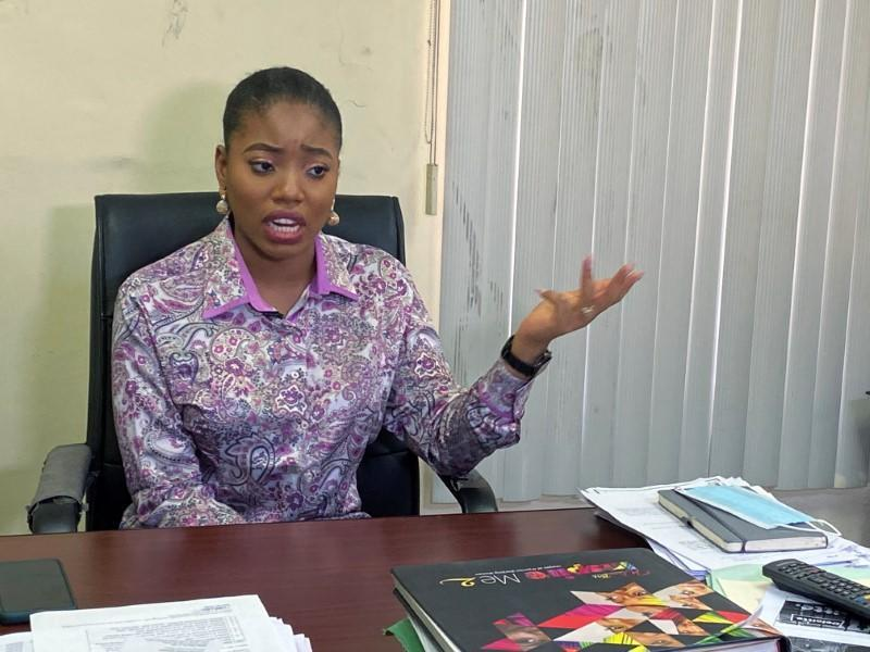 Dumebi Iyeke, a research analyst with Financial Derivatives, speaks during an interview with Reuters at her office in Lagos