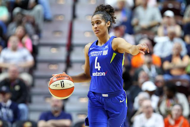 "Though she was critical of the Dallas Wings when she revealed she played while pregnant in 2018, <a class=""link rapid-noclick-resp"" href=""/wnba/players/5059/"" data-ylk=""slk:Skylar Diggins-Smith"">Skylar Diggins-Smith</a> doesn't want to leave the organization. (M. Anthony Nesmith/Getty Images)"
