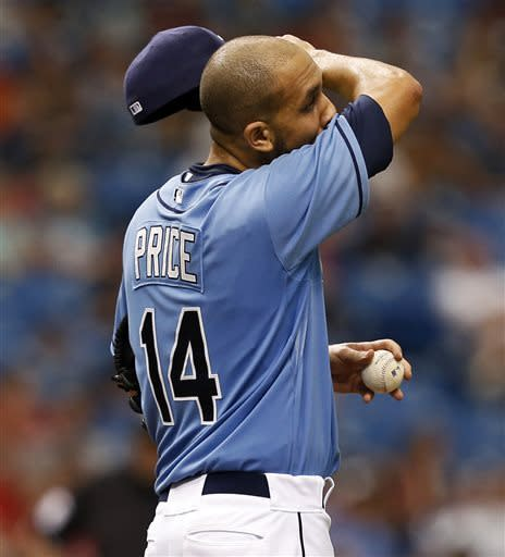 Tampa Bay Rays starting pitcher David Price reacts after giving up a three-run home run to Cleveland Indians' Lonnie Chisenhall during the fifth inning of a baseball game Sunday April 7, 2013, in St. Petersburg, Fla. (AP Photo/Mike Carlson)