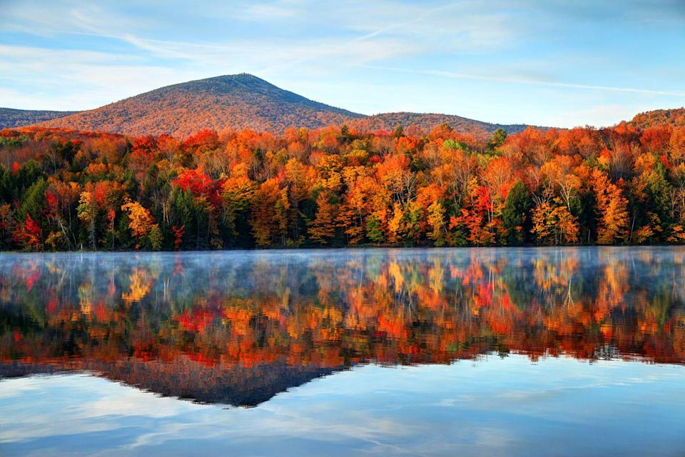 """<p>The reflection in the water of this Vermont landscape means double the <a href=""""https://www.countryliving.com/life/travel/g3657/fall-foliage-tours/"""" rel=""""nofollow noopener"""" target=""""_blank"""" data-ylk=""""slk:fall foliage"""" class=""""link rapid-noclick-resp"""">fall foliage</a>.</p>"""