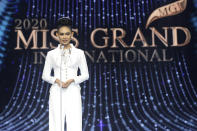 In this photo provided by Miss Grand International, Miss Myanmar, Han Lay, speaks on stage during Miss Grand International contest Saturday, March 27, 2021, in Bangkok, Thailand. The beauty pageant contestant from Myanmar used her brief moment in the spotlight on Saturday night to appeal for international help for her country, on the worst day for bloodshed since the military there staged its coup almost two months ago.(Miss Grand International via AP)