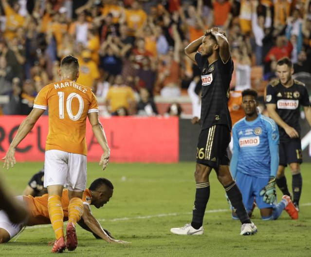 Auston Trusty (center) and the Philadelphia Union lost Wednesday's U.S. Open Cup final to the Houston Dynamo, but remain on pace for the club's best MLS season. (AP Photo/David J. Phillip)