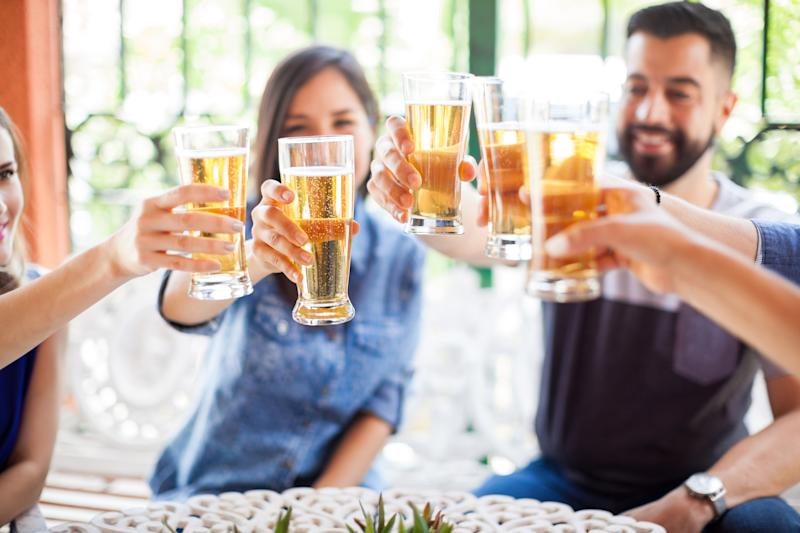 Friends toasting with glasses of beer