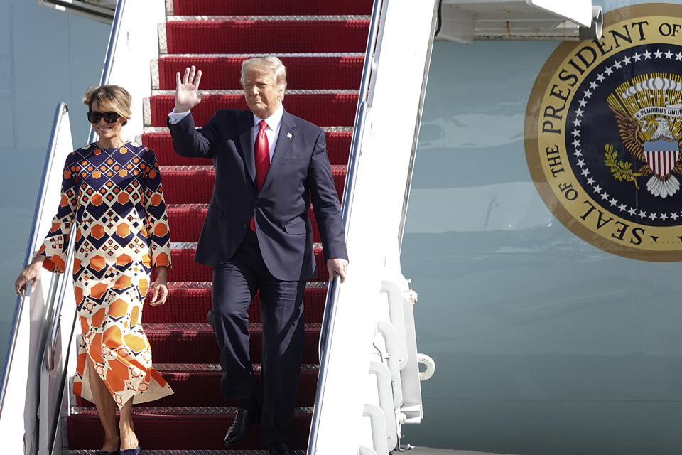 President Donald Trump waves to a handful of supporters as he arrives with first lady Melania Trump at Palm Beach International Airport in West Palm Beach, Fla., Wednesday, Jan. 20, 2021. (Joe Cavaretta/South Florida Sun-Sentinel via AP)