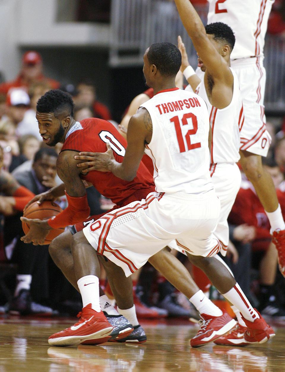 Ohio State's Sam Thompson (12) guards Miami's Geovonie McKnight (0) during the second half of an NCAA college basketball game, Monday, Dec. 22, 2014, in Columbus, Ohio. Ohio State won 93-55. (AP Photo/Mike Munden)