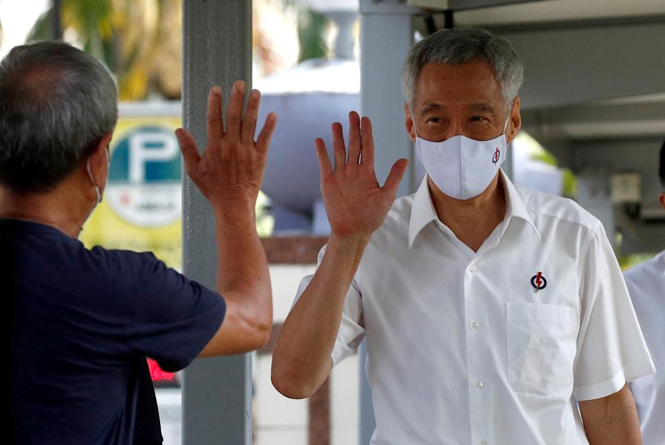 Singapore's Prime Minister Lee Hsien Loong of the ruling People's Action Party arrives at a nomination center ahead of the general election in Singapore June 30, 2020. REUTERS/Edgar Su     TPX IMAGES OF THE DAY