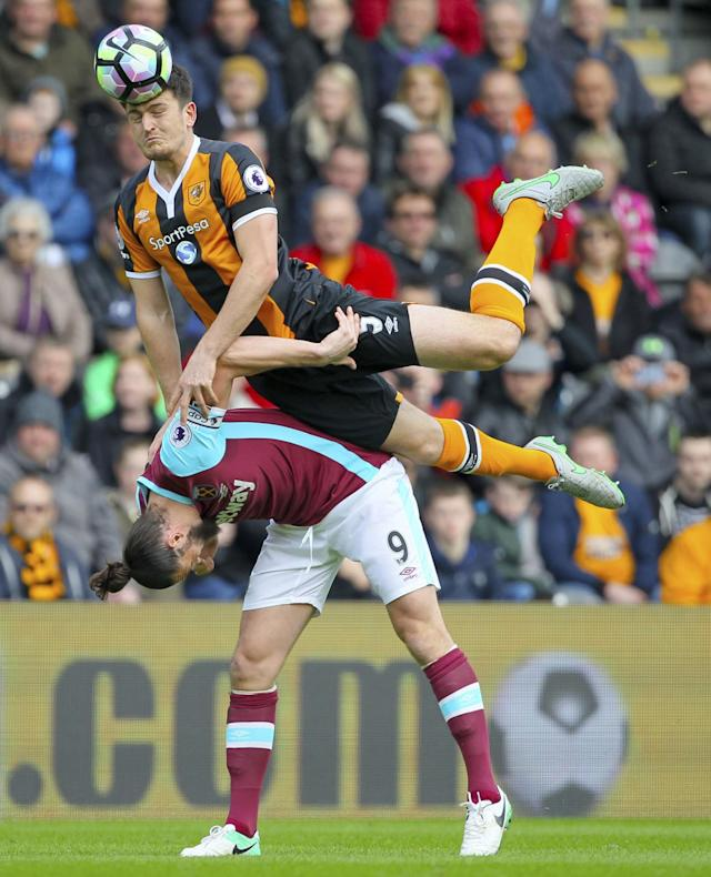 <p>West Ham United's Andy Carroll, left and Hull City's Harry Maguire battle for the ball </p>