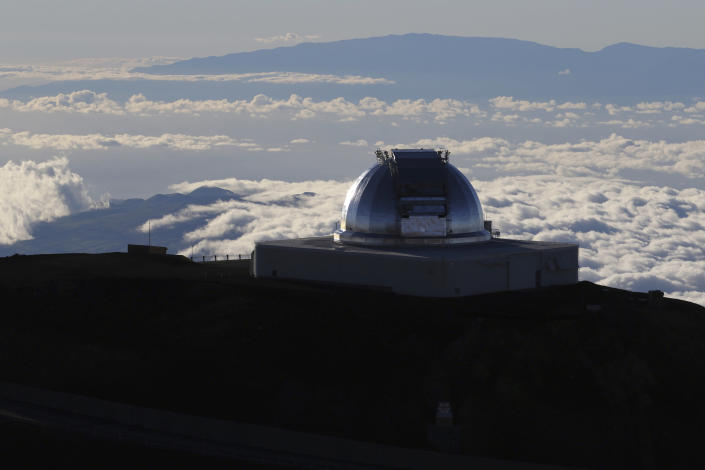 FILE - This July 14, 2019, file photo shows a telescope at the summit of Mauna Kea, Hawaii's tallest mountain. A judicial decision from Spain's Canary Islands has put a halt on an alternative plan to build a giant telescope unpopular in Hawaii, which is the preferred location. Construction of the Thirty Meter Telescope on Hawaii's tallest mountain, Mauna Kea, has been stalled by opponents who say the project will desecrate land that's sacred to some Native Hawaiians. If it can't be built in Hawaii, telescope officials have selected the alternate location on the highest mountain of La Palma, a Spanish island off Africa's western coast. But a court there ruled last month in a decision that just emerged that a public concession for the site was invalid. . (AP Photo/Caleb Jones, File)