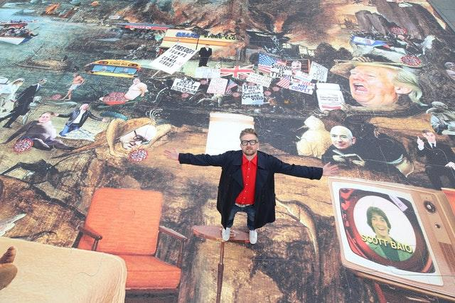 Artist Cold War Steve with his new piece of art, Trumpscape (Danny Lawson/PA)