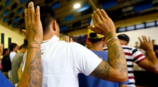Residents take their oaths to reform after heeding a call from Tanauan city government to undergo processing allegedly for being drug-users Monday, July 18, 2016. Photo: AP/Bullit Marquez