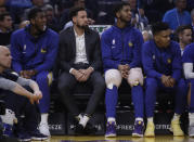 Golden State Warriors' Klay Thompson, second from left, watches action from the bench during the first half of an NBA basketball game against the Memphis Grizzlies Monday, Dec. 9, 2019, in San Francisco. (AP Photo/Ben Margot)