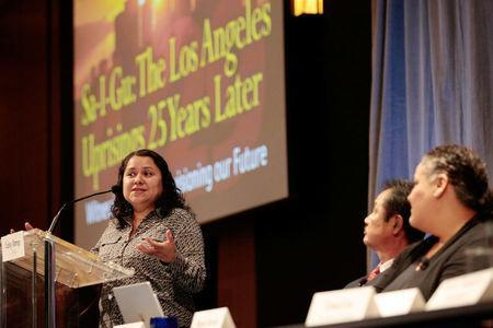 """Professor Leisy Abrego (L) speaks during a panel discussion about the 1992 Los Angeles Riots, """"Sa-I-Gu: The Los Angeles Uprisings 25 Years Later"""" at UCLA in Los Angeles, California, U.S., April 28, 2017. REUTERS/Hyungwon Kang"""