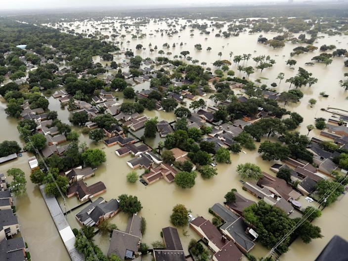 """Water flows into neighborhoods from floodwaters brought on by Tropical Storm Harvey in Houston, Texas, August 29, 2017. <p class=""""copyright"""">Associated Press</p>"""