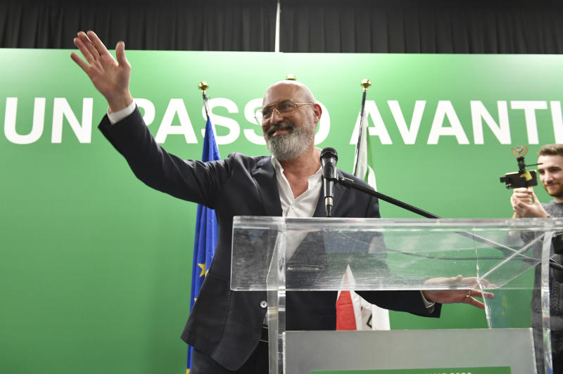 Stefano Bonaccini, president of the Emilia-Romagna Region and Democratic Party candidate, waves to supporters during the closing event of the electoral campaign of the Democratic Party of Emilia-Romagna at the ARCI Benassi club in Bologna, Italy, on Thursday, Jan. 23, 2020. (Massimo Paolone/LaPresse via AP)