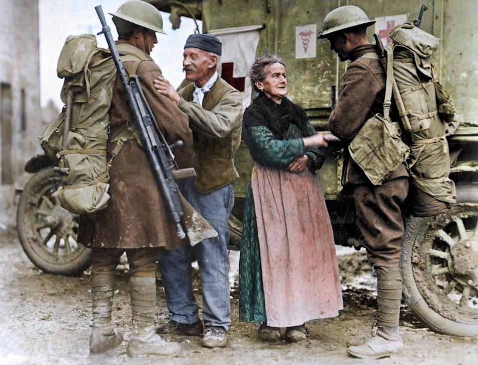 <p>An elderly French couple greet American soldiers after being liberated from four years of German control (Royston Leonard / Media Drum World / Caters News) </p>