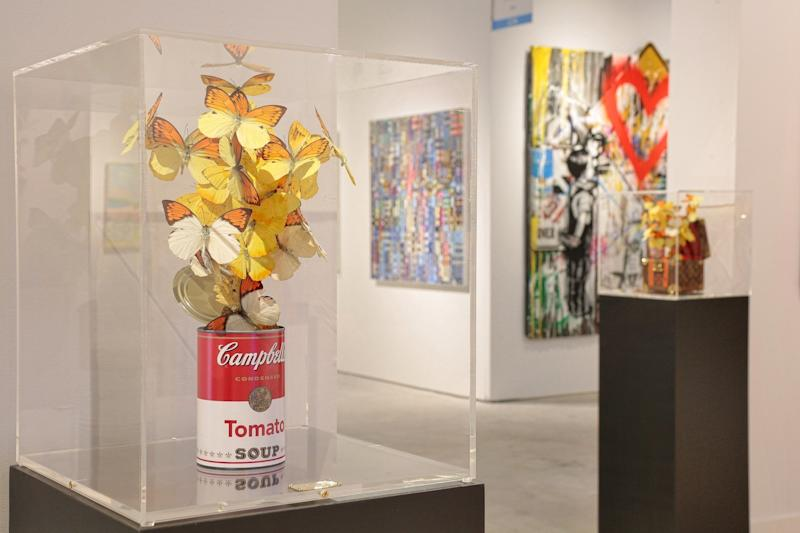 In this piece, Feral's butterflies seem to burst forth from Andy Warhol's iconic Campbell's Tomato Soup can.