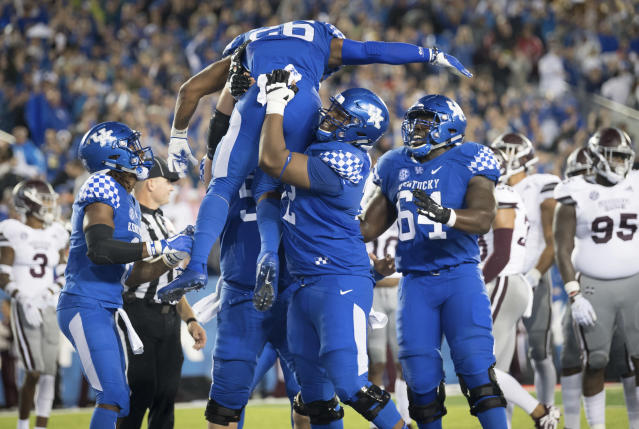 Kentucky running back Benny Snell Jr. (26) is hoisted in celebration following his touchdown during the first half of an NCAA college football game against Mississippi State in Lexington, Ky., Saturday, Sept. 22, 2018. (AP Photo/Bryan Woolston)