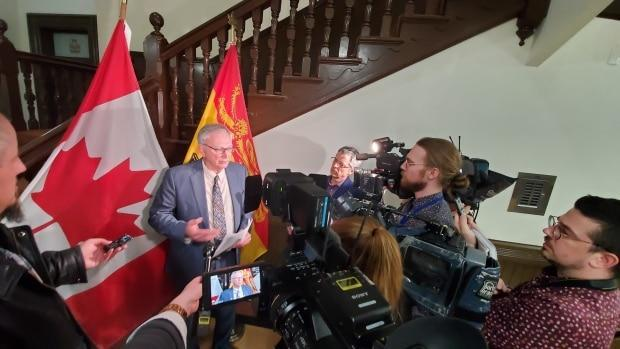 Premier Blaine Higgs tells reporters the all-party committee, made up of cabinet ministers and the four party leaders, began meeting late in the afternoon about closing schools, and he announces its unanimous decision a few hours later. (Photo: Shane Fowler/CBC News - image credit)