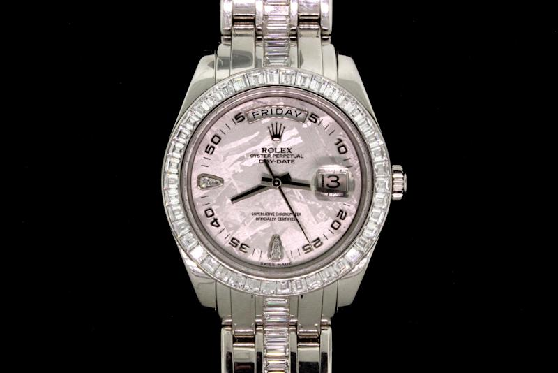 This image provided by Gaston & Sheehan Auctioneers shows a platinum Rolex watch with oyster and diamonds, one of the items being auctioned off Saturday June 1, 2013, in Las Vegas. The auction features precious metals, gems and jewelry confiscated by U.S. Marshals during federal criminal cases. Bidding for the watch begins at $93,500. Buyers can preview the gold and silver bullion, coins, jewelry and watches from federal crime cases Friday at the Las Vegas Convention Center.(AP Photo/Gaston & Sheehan Auctioneers)