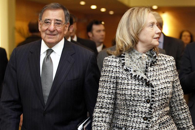 Defense Secretary Leon Panetta and Secretary of State Hillary Rodham Clinton arrive for a meeting with NATO Secretary General Anders Fogh Rasmussen, not pictured, at NATO Headquarters in Brussels, Belgium, Wednesday, April 18, 2012. (AP Photo/Jacquelyn Martin, Pool)