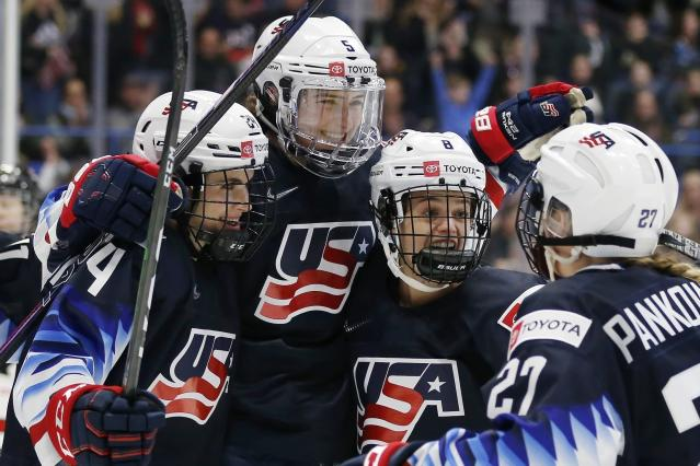 United States' Megan Keller (5) celebrates her goal with Dani Cameranesi (24), Emily Matheson (8) and Annie Pankowski (27) during the first period of a rivalry series women's hockey game against Canada in Hartford, Conn., Saturday, Dec. 14, 2019. (AP Photo/Michael Dwyer)