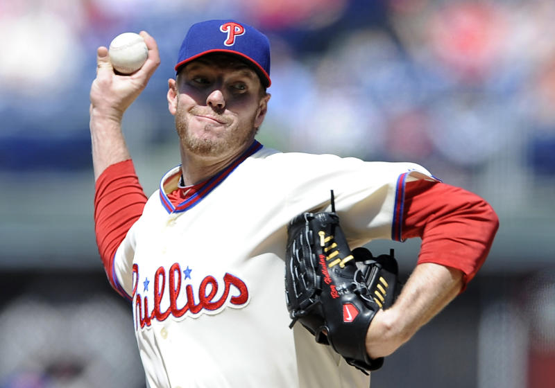 Philadelphia Phillies' Roy Halladay throws a pitch in the first inning of a baseball game against the Miami Marlins, Sunday, May 5, 2013, in Philadelphia. (AP Photo/Michael Perez)