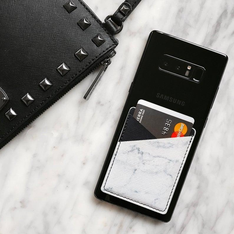 <p>This marble-print <span>Phone Card Holder Wallet</span> ($10) will make running errands easier and streamline your wallet.</p>