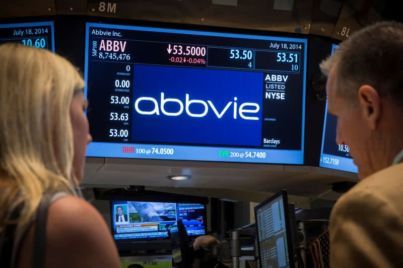 A screen displays the share price for drugmaker AbbVie on the floor of the New York Stock Exchange