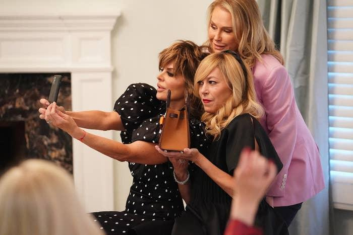 Photo of Lisa Rinna, Kathy Hilton, and Sutton Stracke taking a selfie together on the set of Real Housewives of Beverly Hills