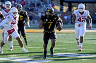 Missouri running back Tyler Badie scores on a touchdown run during the second half of an NCAA college football game against Arkansas Saturday, Dec. 5, 2020, in Columbia, Mo. Missouri won the game 50-48. (AP Photo/L.G. Patterson)