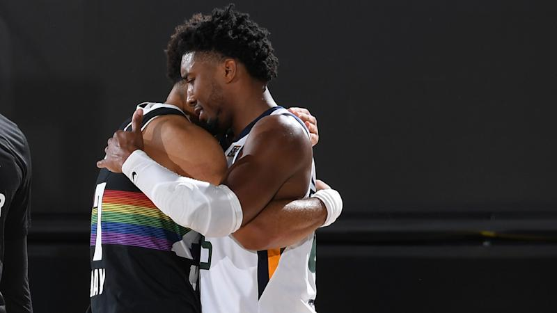 ORLANDO, FL - SEPTEMBER 1: Jamal Murray #27 of the Denver Nuggets hugs Donovan Mitchell #45 of the Utah Jazz after Round One, Game Seven of the NBA Playoffs on September 1, 2020 at AdventHealth Arena in Orlando, Florida. NOTE TO USER: User expressly acknowledges and agrees that, by downloading and/or using this Photograph, user is consenting to the terms and conditions of the Getty Images License Agreement. Mandatory Copyright Notice: Copyright 2020 NBAE (Photo by Andrew D. Bernstein/NBAE via Getty Images)