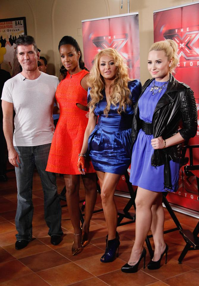 "UNIONDALE, NY - JUNE 20:  (L-R) ""The X Factor"" Judges Simon Cowell, Kelly Rowland, Paulina Rubio and Demi Lovato attend the ""The X Factor"" Judges press conference at Nassau Veterans Memorial Coliseum on June 20, 2013 in Uniondale, New York.  (Photo by Janette Pellegrini/FilmMagic)"