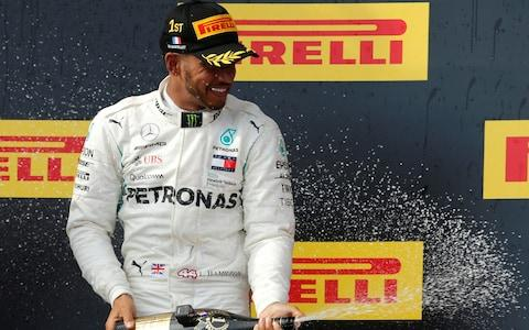 Circuit Paul Ricard, Le Castellet, France - June 24, 2018 Mercedes™ Lewis Hamilton celebrates on the podium after winning the race - Credit: REUTERS