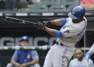 Toronto Blue Jays' Curtis Granderson hits a single against the Chicago White Sox during the first inning of a baseball game Saturday, July 28, 2018, in Chicago. (AP Photo/Nam Y. Huh)