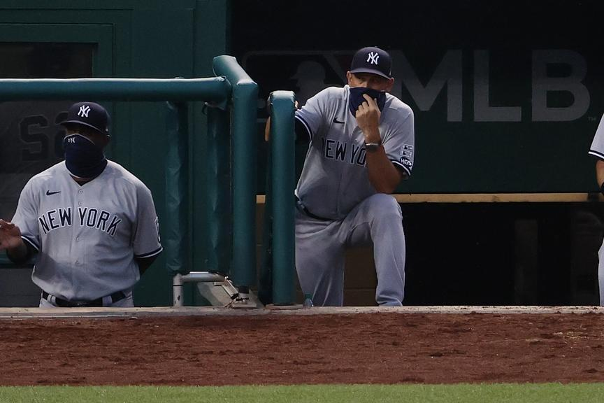 Aaron Boone looks on from the dugout