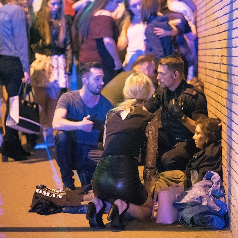 Injured concert-goers outside Manchester Arena - Credit:  Joel Goodman/LNP